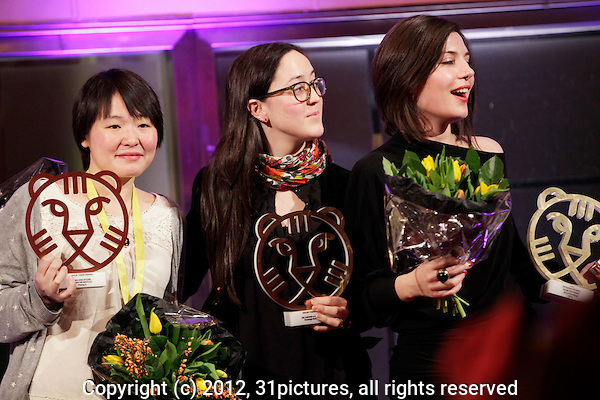 The Netherlands, Rotterdam, 03 February 2012. Award Ceremony International Film Festival Rotterdam 2012. Winners Hivos Tiger Award, from left; Huang Ji (Egg and Stone), Dominga Sotomayor (De jueves a domingo) and Maja Milos (Clip) Photo: 31pictures.nl / (c) 2012, www.31pictures.nl Copyright and ownership by photographer. FOR IFFR USE ONLY. Not to be (re-)distributed in any form. Copyright and ownership by photographer. FOR IFFR USE ONLY. Not to be (re-)distributed in any form.