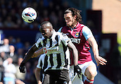 04.05.2013 London, England. Cheick Tiote of Newcastle United and Andy Carroll of West Ham United on Loan from Liverpool during the Premier League game between West Ham United and Newcastle United from Boleyn Ground, Upton Park.