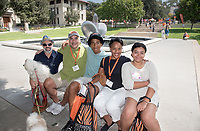 From right, Sara Juantorena '21 and her family, Debbie, Julian, Jorge and Hernan relax near Gilman Fountain after moving in from Brooklyn. Incoming first-years and their families are welcomed by O-Team members and the community at the start of Occidental College's Fall Orientation for the class of 2021, Aug. 24, 2017.<br /> (Photo by Marc Campos, Occidental College Photographer)