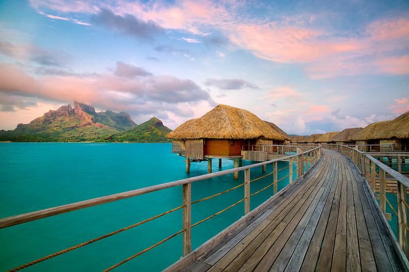 Bungalows over water and Mt. Otemanu. Bora Bora. French Polynesia