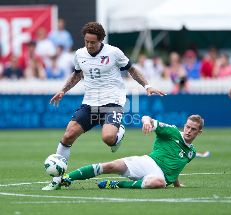 Jermaine Jones (13) of the USMNT steps out of the tackle of Sven Bender (16) of Germany during the game at RFK Stadium in Washington DC.  The USMNT defeated Germany, 4-3, in a friendly match.