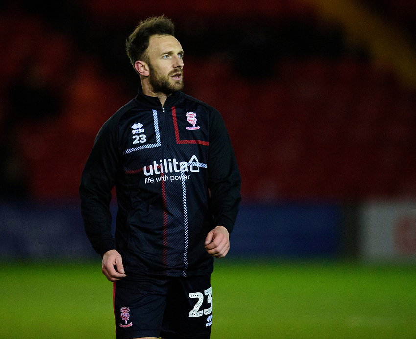 Lincoln City's Neal Eardley during the pre-match warm-up<br /> <br /> Photographer Andrew Vaughan/CameraSport<br /> <br /> The EFL Sky Bet League One - Lincoln City v Milton Keynes Dons - Tuesday 11th February 2020 - LNER Stadium - Lincoln<br /> <br /> World Copyright © 2020 CameraSport. All rights reserved. 43 Linden Ave. Countesthorpe. Leicester. England. LE8 5PG - Tel: +44 (0) 116 277 4147 - admin@camerasport.com - www.camerasport.com
