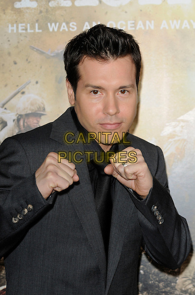 "JON SEDA .The Los Angeles premiere of HBO's new miniseries event ""The Pacific"" at Grauman's Chinese Theatre in Hollywood, California.  .February 24th, 2010.half length suit jacket hands fists ring black grey gray .CAP/ROT.©Lee Roth/Capital Pictures"