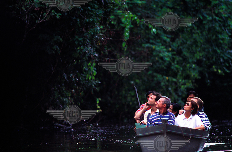 ©Chris Stowers/Panos Pictures..Tourists on the Kitabatangan River in Sabah, East Malaysia, on the look-out for ellusive Probosis monkeys.