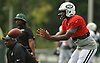 Geno Smith #7, New York Jets quarterback, takes a snap during team training camp at Atlantic Health Jets Training Center in Florham Park, NJ on Friday, Aug. 5, 2016