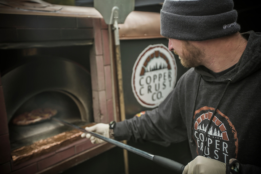Copper Crust Pizza food truck serves up wood-fired pizzas during Fresh Coast FIlm Festival in Marquette, Michigan.