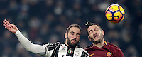 Calcio, Serie A: Juventus vs Roma. Torino, Juventus Stadium,17 dicembre 2016. <br /> Juventus&rsquo; Gonzalo Higuain, left, and Roma&rsquo;s Kostas Manolas jump for the ball during the Italian Serie A football match between Juventus and Roma at Turin's Juventus Stadium, 17 December 2016.<br /> UPDATE IMAGES PRESS/Isabella Bonotto