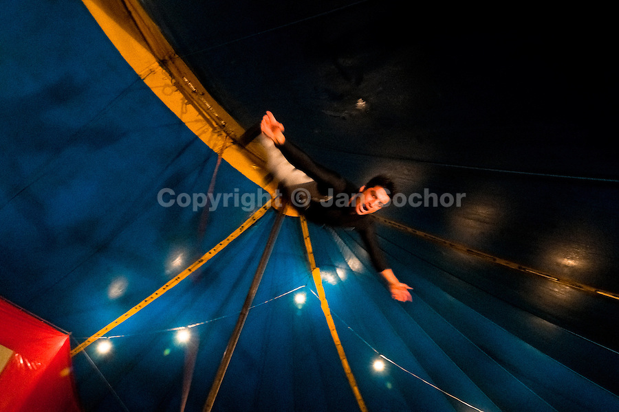 A Colombian man performs a flying trapeze act at the Circo Anny, a family run circus wandering the Amazon region of Ecuador, 4 July 2010. The Circo Anny circus belongs to the old-fashioned traveling circuses with a usual mixture of acrobat, clown and comic acts. Due to the general loss of popularity caused by modern forms of entertainment such as movies, TV shows or internet, these small family enterprises balance on the edge of survival. Circuses were pushed away and now they have to set up their shows in more remote villages. The circus art and culture is slowly dying.