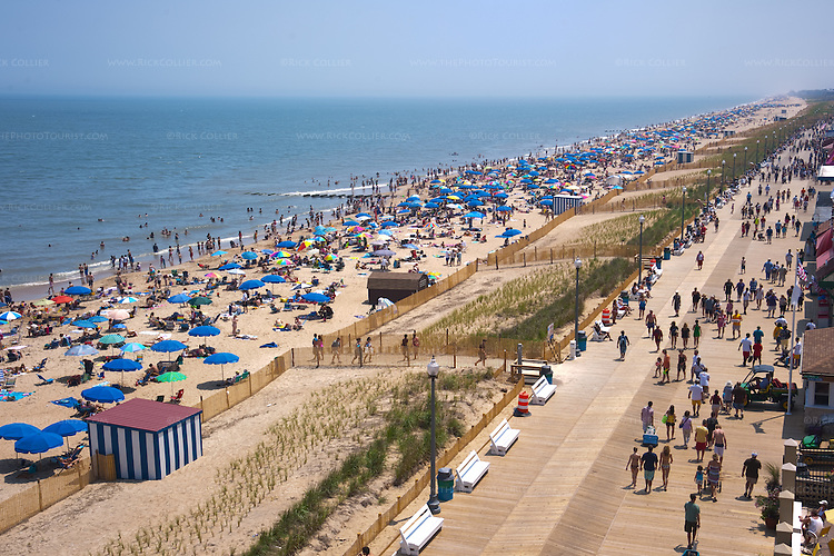 From a high vantage point, on a summer day the beach at Rehoboth Beach, Delaware, looks like a carpet of umbrellas and sunbathers.  (This image was published in the July 2010 issue of The Washingtonian Magazine.)