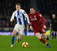 Liverpool's Andrew Robertson (right) vies for possession with Brighton & Hove Albion's Solly March (left) <br /> <br /> Photographer David Horton/CameraSport<br /> <br /> The Premier League - Brighton and Hove Albion v Liverpool - Saturday 12th January 2019 - The Amex Stadium - Brighton<br /> <br /> World Copyright © 2018 CameraSport. All rights reserved. 43 Linden Ave. Countesthorpe. Leicester. England. LE8 5PG - Tel: +44 (0) 116 277 4147 - admin@camerasport.com - www.camerasport.com