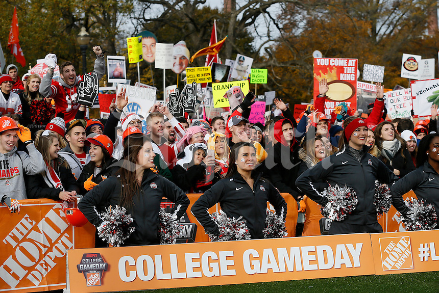 Spectators and Ohio State cheerleaders watch the taping of ESPN's College GameDay broadcast from the campus of Ohio State prior to the NCAA football game against the Michigan State Spartans in Columbus on Nov. 21, 2015. (Adam Cairns / The Columbus Dispatch)