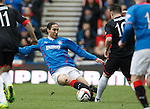 Bilel Mohsni charges in and misses the ball catching Ross Forbes on the leg and getting booked