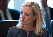 Newly confirmed  United States Secretary for Homeland Security Kirstjen Nielsen listens as US President Donald J. Trump speaks to the media during a Cabinet meeting at the White House on December 6, 2017 in Washington, D.C. <br /> Credit: Kevin Dietsch / Pool via CNP