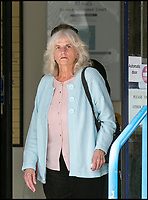 BNPS.co.uk (01202 558833)Pic: LeeMcLean/BNPS<br /> <br /> Susan Hind (69), at Poole Magistrates Court yestertday.<br /> <br /> A carer who subjected a 78-year-old dementia sufferer to &quot;cruel&quot; and &quot;degrading&quot; treatment today faces jail after she was caught on CCTV cameras installed by the woman's daughter.<br /> <br /> Susan Hind, 69, subjected vulnerable Martha Davison to abuse, threats, mockery and undignified acts, calling her a &quot;dirty bitch&quot; and pushing a bag of soiled clothes close to her face at her home in Bournemouth, Dorset.<br /> <br /> As she pleaded guilty to three counts of ill-treatment or wilful neglect of an individual on Thursday, Poole Magistrates were shown multiple clips of CCTV that showed Hind shouting at and degrading the elderly woman.<br /> <br /> Hind held her head in her hands as the footage was shown in which she told the elderly woman she &quot;made her sick&quot; and called her a disgrace and a &quot;dirty, disgusting person&quot;.