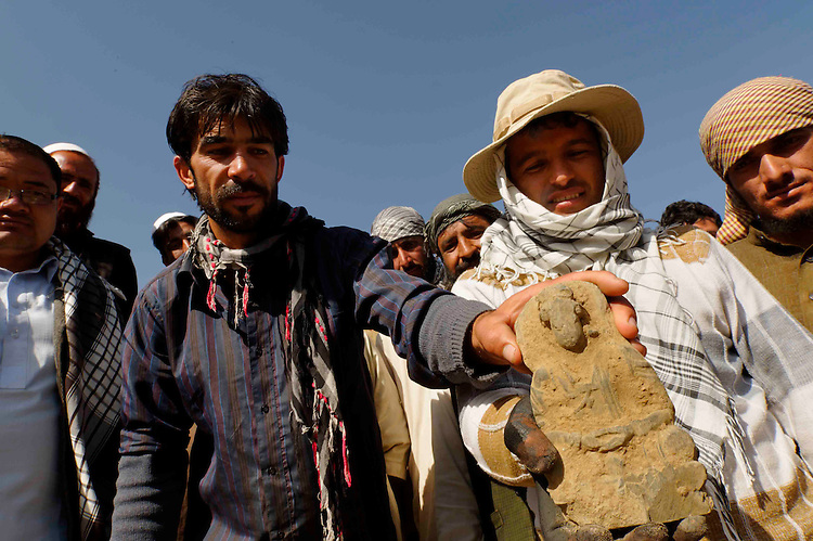 JALREZ VALLEY, MES AYNAC,AFGHANISTAN - MAY 12- a team of diggers headed by Marek Lemiesz a Polish archeologist just discovered a stone statue - hundreds of Afghan and foreign archaeologists and 550 workers work on the site of  Mes Aynak