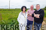 NOT NEAR OUR HOMES: Ciara Flavin, Barry Healy and Tony Dowd, pictured at the site where many wind turbines will be erected shortly in the Asdee area.