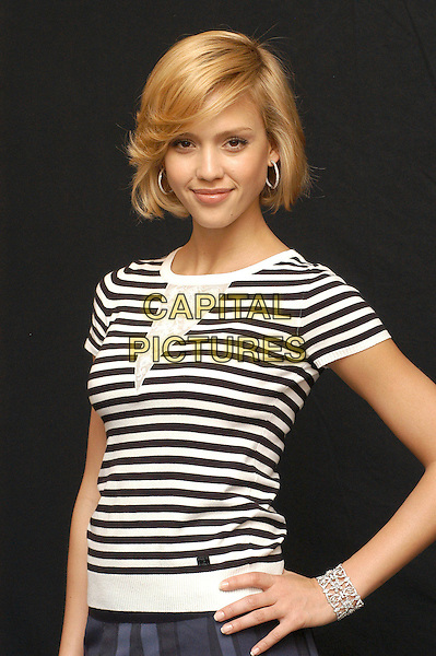 "JESSICA ALBA.Photocall for ""Sin City"", Rome, Italy, .May 25th 2005..half length stripes striped top t-shirt t shirt nautical black and white bracelet cuff hand on hip.Ref: CAV.www.capitalpictures.com.sales@capitalpictures.com.©Luca Cavallari/Capital Pictures."