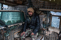 A soldier looking tired at his position. According to lieutenant Mohamed Karim, when they don't get attacked by Pakistani, it's the village down the checkpoint and the Talibans targetting them, Kunar, Afghanistan, 16th November 2017. <br /> <br /> Un soldat semble épuisé à son poste. Selon le lieutenant Mohamed Karim , quand ils ne sont pas attaqués par les Pakistanais, c'est le village au-dessous du post avancé et les talibans qui les ciblent, Kunar, Afghanistan, le 16 novembre 2017.