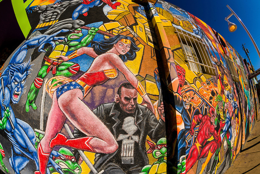 "Mural of comic book super heroes on the side of ""Masks Y Mas"" store, Albuquerque, New Mexico USA"