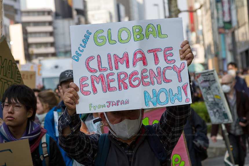 "An older man holds a sign as he joins young  people taking part in the Global Strike for Future at the United Nations University, Shibuya, Tokyo, Japan.Friday March 15th 2019. Part of a global day of action in 98 countries and nearly 2,000 cities; this was Japan's second Fridays for Future event, known as ""School strikes"", and took place from 2pm to 4pm with activists and students holding signs demanding leaders, internationally and nationally, take measures to reduce ecologically damaging activities. The movement was started in 2018 by Swedish schoolgirl, Greta Thunberg, who began striking from her lessons when she realised that adult leaders were doing nothing to ensure there would be the future she was studying for."