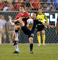 Johnny Evans (23) of Manchester United fights for the ball with Jack McInerney (19) of Philadelphia Union during a friendly match at Lincoln Financial Field in Philadelphia, Pennsylvania.  Manchester United defeated Philadelphia Union, 1-0.