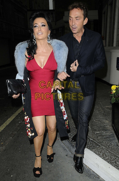 Nancy Dell'Olio & Bruno Tonioli .The Terrence Higgins Trust: Friends For Life charity dinner, Park Lane Hotel, Piccadilly, London, England..June 14th, 2012.full length black suit red dress blue fur wrap cleavage clutch bag mouth open black suit  jacket shirt jeans denim.CAP/CAN.©Can Nguyen/Capital Pictures.