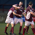 Stenny's Eddie Malone (left) is congratulated by Nicky Devlin (2) after he headed home the equalising goal.