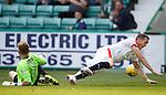 Jon Daly taken down by Hibs keeper Mark Oxley