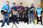 Gary Rellis, Tony Corcoran, Shane McConnon and Donal Mulligan busking for SOSAD with Mayor of Drogheda Frank Godfrey and Liam Duffy in the Laurence Centre. Photo:Colin Bell/pressphotos.ie
