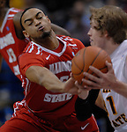 Illinois State Redbirds guard Anthony Cousin (5) reaches in for the ball as Wichita State Shockers guard Ron Baker (31) moves towards the basket in the second semifinal game of the Missouri Valley Conference Tournament. The Illinois State Redbirds played against the Wichita State Shockers on Saturday March 9, 2013 at the Scottrade Center in St. Louis, Missouri.