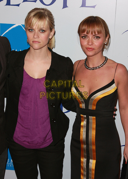 "REESE WITHERSPOON & CHRISTINA RICCI.""Penelope"" Los Angeles Premiere held at the Directors Guild of America Theater. Photo Credit: Charles Harris/AdMedia.February 20th, 2008.half length dress yellow silver grey gray stripes striped purple top jacket tattoo.CAP/ADM/CH.©Charles Harris/AdMedia/Capital Pictures"