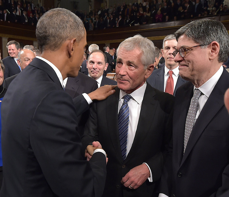 US President Barack Obama shakes hands with US Secretary of Defense Chuck Hagel (C) as Secretary of the Treasury Jacob Lew (R) watches after Obama delivered the State of The Union address on January 20, 2015, at the US Capitol in Washington, DC. <br /> Credit: Mandel Ngan / Pool