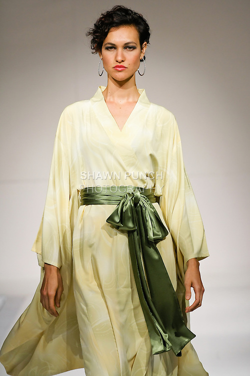 Model walks the runway in an outfit by Telina Webb for the KabukiU Spring Summer 2011 collection fashion show, during Nolcha Fashion Week, September 14, 2010.