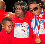 Family members of player Artreal Jones were presented his medals for the 2013 and 2014 UIL State Basketball Championships during a celebration at Yates High School, September 2, 2014., 2014.