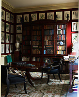 The dining room walls are lined with 1820s botanical prints and the Regency bookcase is Irish.