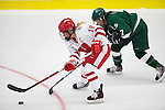 Wisconsin Badgers Brianna Decker (18) handles the puck opening night against the Bemidji State Beavers at the LaBahn Arena Friday, October 19, 2012 in Madison, Wis. (Photo by David Stluka)