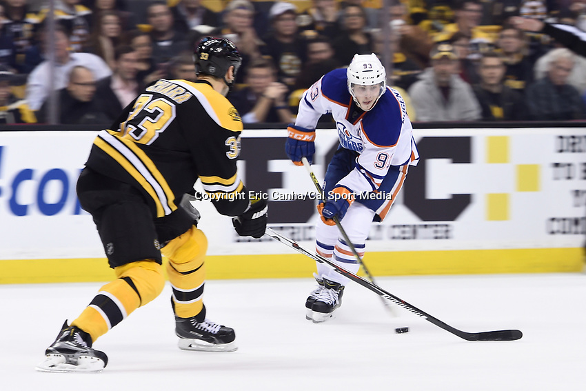 Monday, December 14, 2015: Edmonton Oilers center Ryan Nugent-Hopkins (93) tries working the puck past Boston Bruins defenseman Zdeno Chara (33) during the National Hockey League game between the Edmonton Oilers and the Boston Bruins held at TD Garden, in Boston, Massachusetts. Edmonton defeats Boston 3-2 in overtime. Eric Canha/CSM