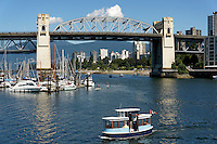 False Creek ferry with Burrard Bridge and West End in back, Vancouver, British Columbia, Canada
