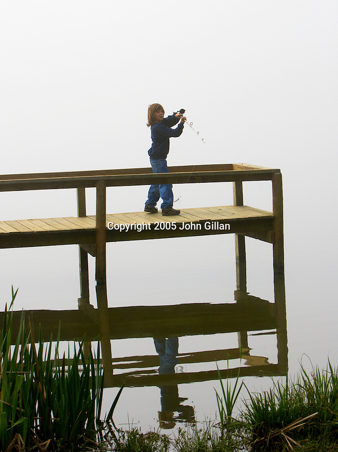 Child fishing at Lake Talavana in Havana, Florida during the winter. File # JP201839