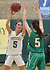 Jane DiGregorio #5 of Mattituck, left, looks to make a pass during the NYSPHSAA varsity girls basketball Class B Southeast Regional Final against Irvington at SUNY Old Westbury on Thursday, March 9, 2017. Irvington defeated Mattituck by a score of 62-37.
