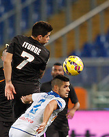 Calcio, Tim Cup: Roma vs Empoli. Ottavi di finale a gara unica. Roma, stadio Olimpico, 20 gennaio 2015.<br /> Roma's Juan Iturbe, left, and Empoli's Vincent Laurini fight for the ball during the Italian Cup round of 16 football match between Roma and Empoli at Rome's Olympic stadium, 20 January 2015.<br /> UPDATE IMAGES PRESS/Riccardo De Luca