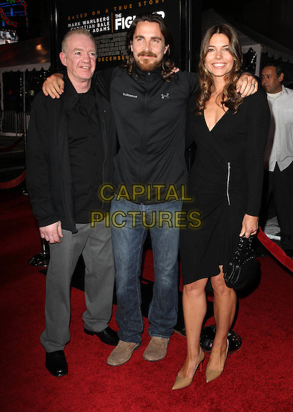 "DICKY ECKLUND, CHRISTIAN BALE & SIBI BLAZIC .""The Fighter"" Los Angeles Premiere held At The Grauman's Chinese Theatre,  Hollywood, CA, 6th December 2010..full length married couple husband wife black dress wrap zip jacket jeans arm around .CAP/ADM/KB.©Kevan Brooks/AdMedia/Capital Pictures."