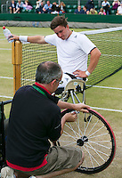 July 5, 2014, United Kingdom, London, Tennis, Wimbledon, AELTC, Wheelchairtennis, Gordon Reid (GBR) got a flat tire and is helped out<br /> Photo: Tennisimages/Henk Koster