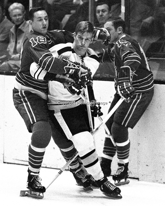 Seals try to wrap up Boston Bruins Bobby Orr.<br />