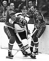 Seals try to wrap up Boston Bruins Bobby Orr.<br />                              (1970 photo/Ron Riesterer)