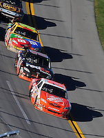 Nov. 1, 2009; Talladega, AL, USA; NASCAR Sprint Cup Series driver Joey Logano (20) leads teammates Denny Hamlin (11) and Kyle Busch (18) during the Amp Energy 500 at the Talladega Superspeedway. Mandatory Credit: Mark J. Rebilas-