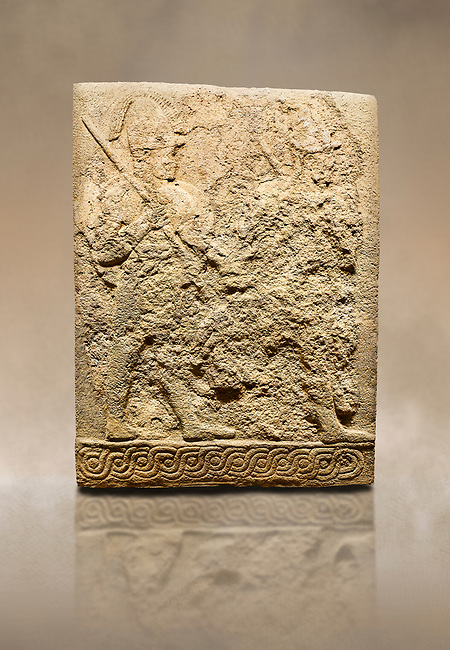 Photo of Hittite sculpted orthostats panels of Long Wall Limestone, Karkamıs, (Kargamıs), Carchemish (Karkemish), 900-700 B.C. Soldiers. Anatolian Civilisations Museum, Ankara, Turkey<br /> <br /> Figure of two helmeted warriors. They have their shield in their back and their spear in their hand. The prisoner in their front is depicted as small. The lower part of the orthostat is decorated with braiding motifs. <br /> <br /> On a brown art background.