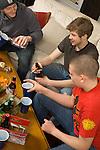Teenage boys smoking cigarettes and drinking alcohol