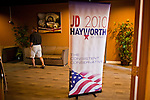 July 14 - PEORIA, AZ: A man walks past a JD Hayworth campaign sign in a hotel lobby in Peoria, AZ. Hayworth spoke to a Tea Party gathering in a hotel meeting room in Peoria. Hayworth, an ultra conservative, is running to the right of McCain and has painted McCain as a moderate to liberal Senator in the mold John Kerry (D-MA).     Photo by Jack Kurtz