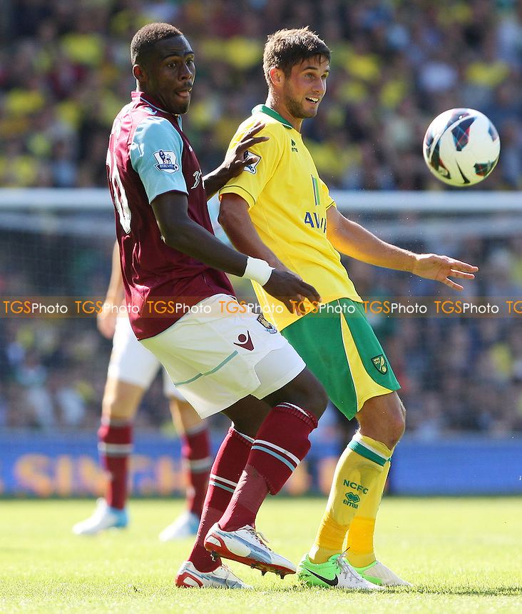 Guy Demel of West Ham and Andrew Surman of Norwich - Norwich City vs West Ham United, Barclays Premier League at Carrow Road, Norwich - 15/09/12 - MANDATORY CREDIT: Rob Newell/TGSPHOTO - Self billing applies where appropriate - 0845 094 6026 - contact@tgsphoto.co.uk - NO UNPAID USE.